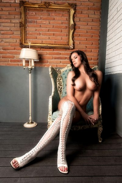 lounge, chair, thigh high boots, lace up, lamp, brick wall