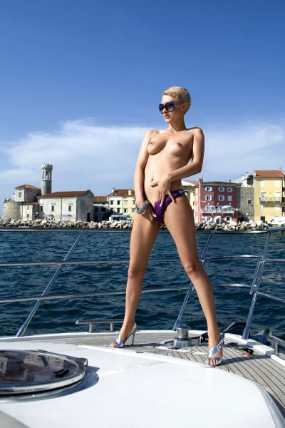 Model appeared on cover,  PB Slovenia Playmate of the Year 2009, yacht, boat, sea, sunglasses, swimsuit